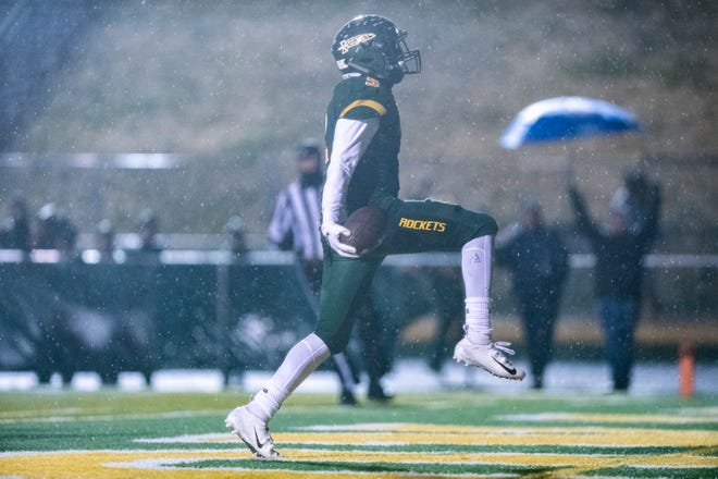 Reynolds' Jhari Patterson runs in for a touchdown during their Friday night playoff game against Sun Valley  Nov. 23, 2018.