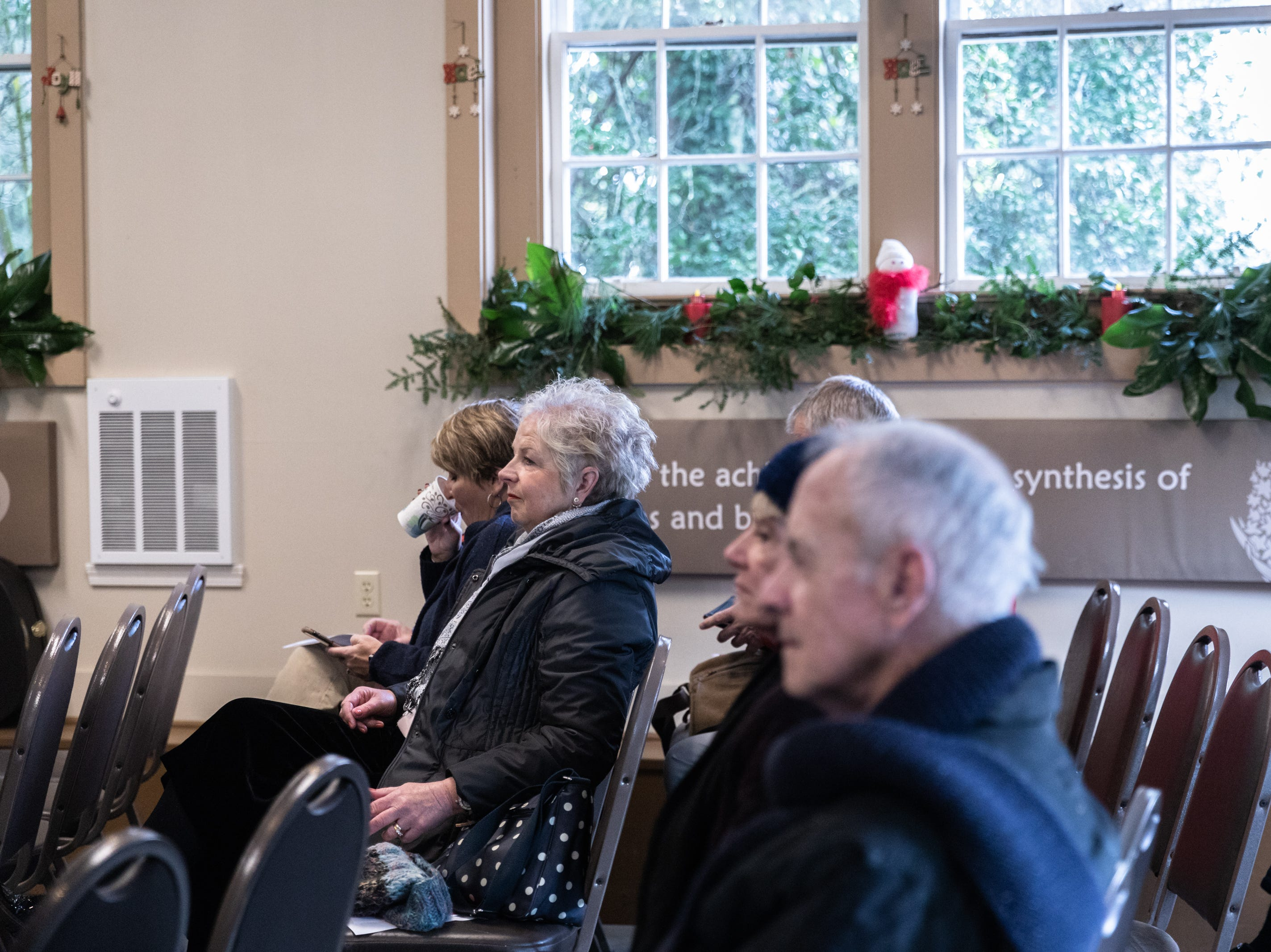 Visitors to the Carl Sandburg home listen to live music by Jean Satz and Alan Satz who go by the name Geriatric Jukebox, while the park celebrated its 50th anniversary Nov. 24, 2018, with their Christmas at Connemara event featuring live music, storytellers and tours of the home.