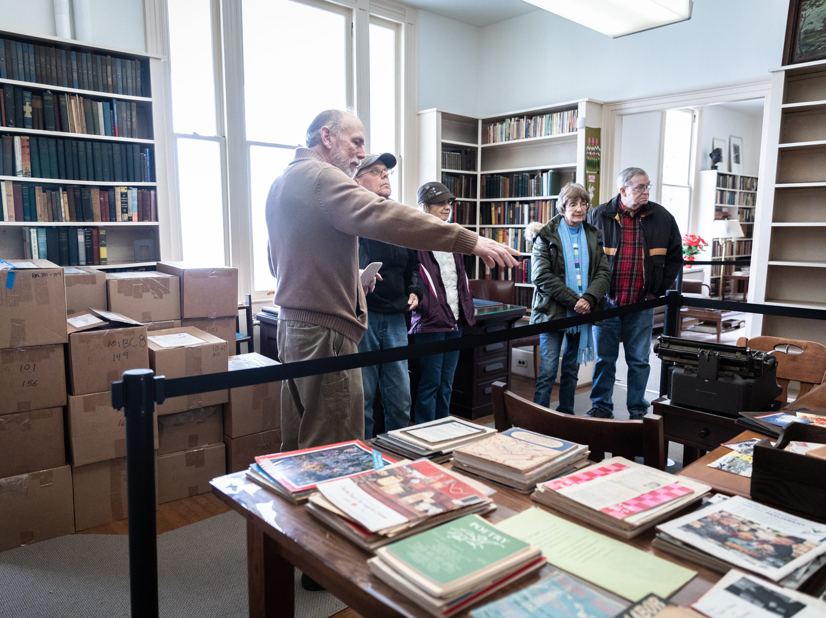 Bill White, a volunteer with the Carl Sandburg home, guides a tour through the house where the park celebrated its 50th anniversary Nov. 24, 2018, with their Christmas at Connemara event featuring live music, storytellers and tours of the home.