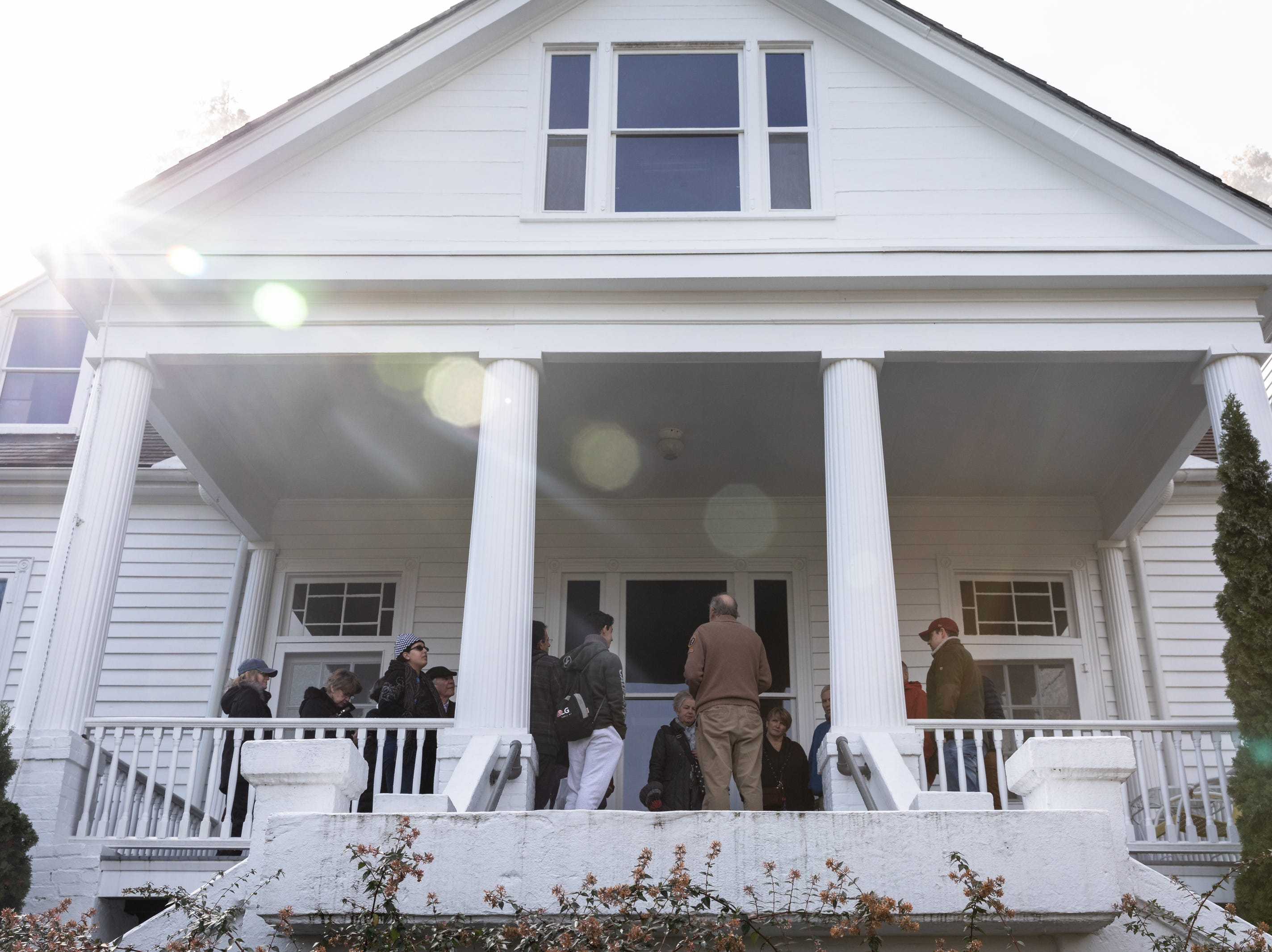 A group tours the Carl Sandburg home in Flat Rock where the park celebrated its 50th anniversary Nov. 24, 2018, with their Christmas at Connemara event featuring live music, storytellers and tours of the home.