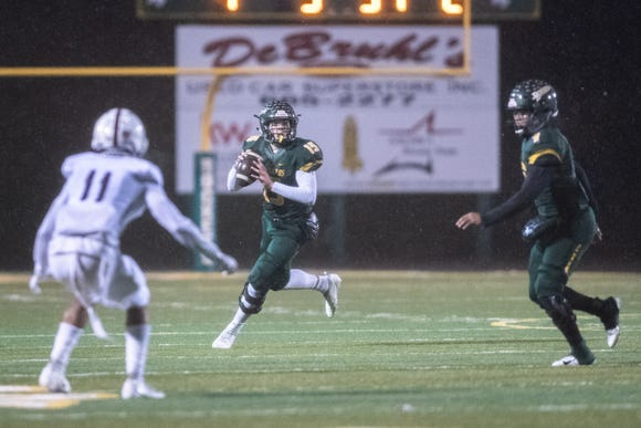 Reynolds' Alex Flinn looks to pass the ball during their Friday night playoff game against Sun Valley  Nov. 23, 2018.