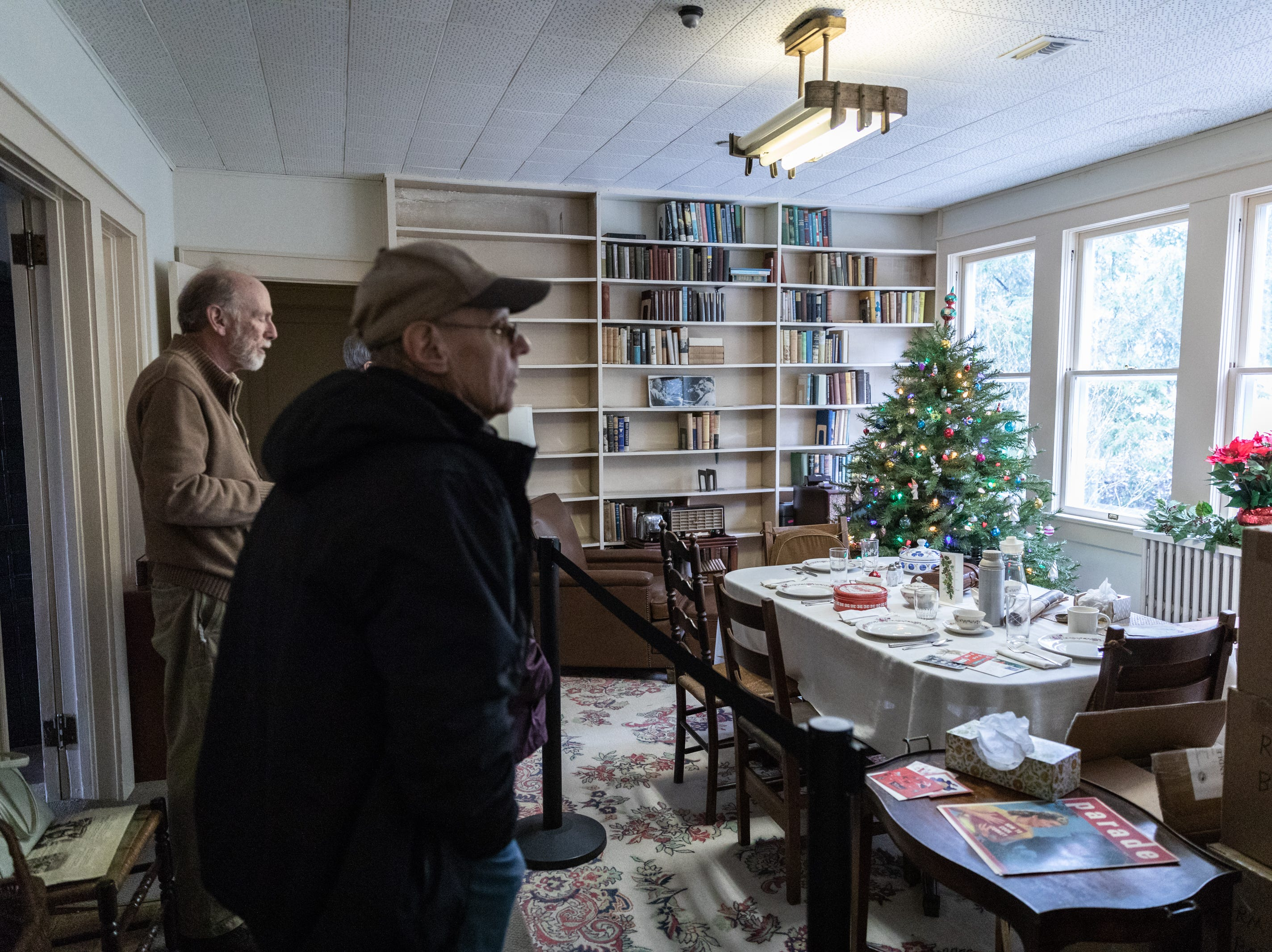 Visitors to the Carl Sandburg home tour the house while the park celebrated its 50th anniversary Nov. 24, 2018, with their Christmas at Connemara event featuring live music, storytellers and tours of the home.