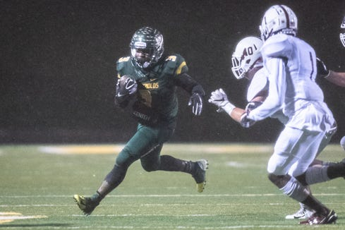 Reynolds' Markeese Jackson runs the ball during their Friday night playoff game against Sun Valley Nov. 23, 2018.
