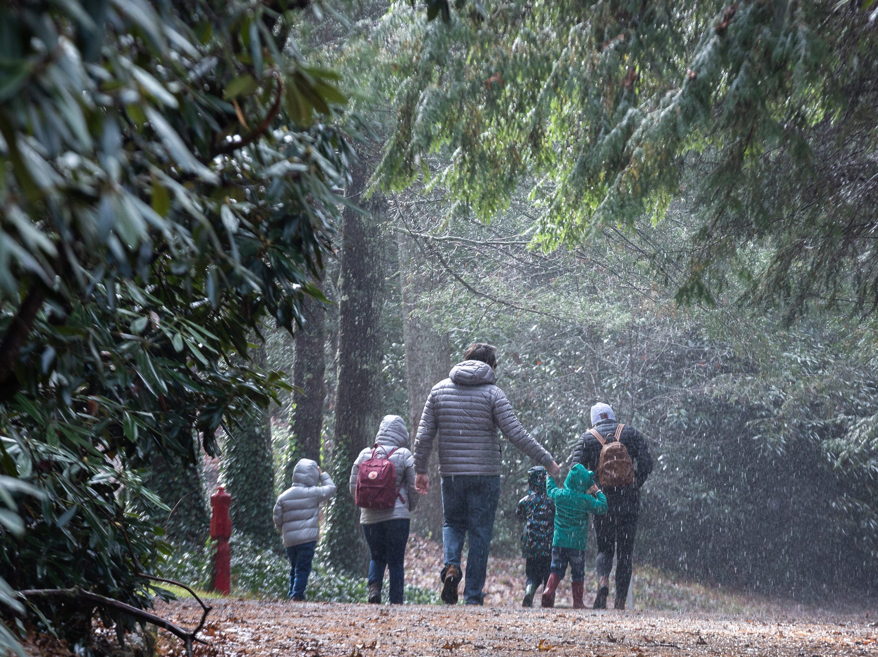 A family walks towards the goat barn at the Carl Sandburg home in Flat Rock where the park celebrated its 50th anniversary Nov. 24, 2018, with their Christmas at Connemara event featuring live music, storytellers and tours of the home.
