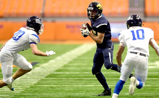 Susquehanna Valley's Sethan King (35) attempts to get past Jack Beglieri (20) and Emilio Nolasco (10) of Dobb's Ferry. Susquehanna Valley vs. Dobbs Ferry, Class C NYSPHSAA state football final, Carrier Dome, Syracuse. Friday, November 23, 2018.