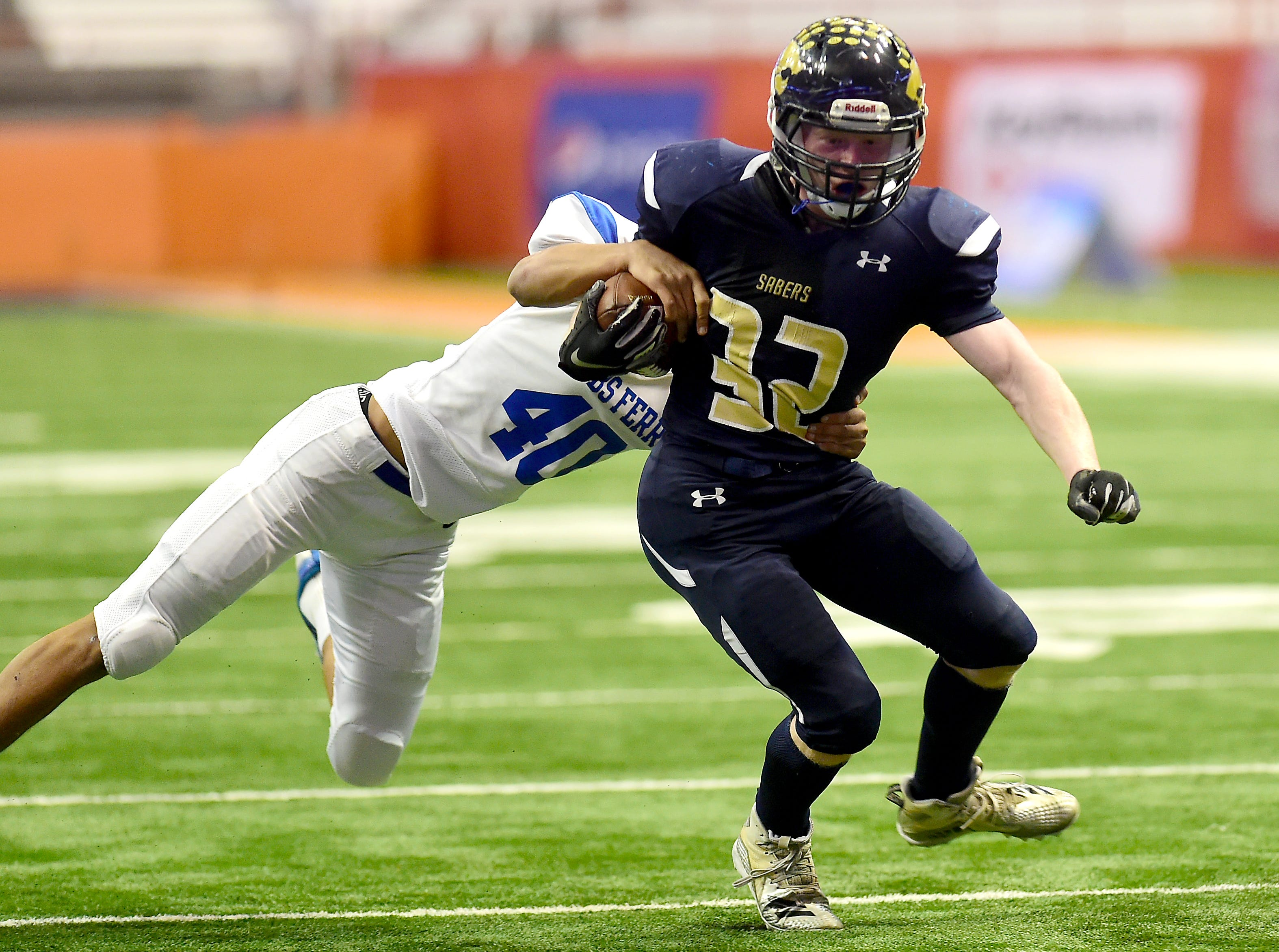 Keyle Leonard of Susquehanna Valley (32) attempts to get past Justin Morgan (40) during Susquehanna Valley vs. Dobbs Ferry, Class C NYSPHSAA state football final, Carrier Dome, Syracuse. Friday, November 23, 2018.