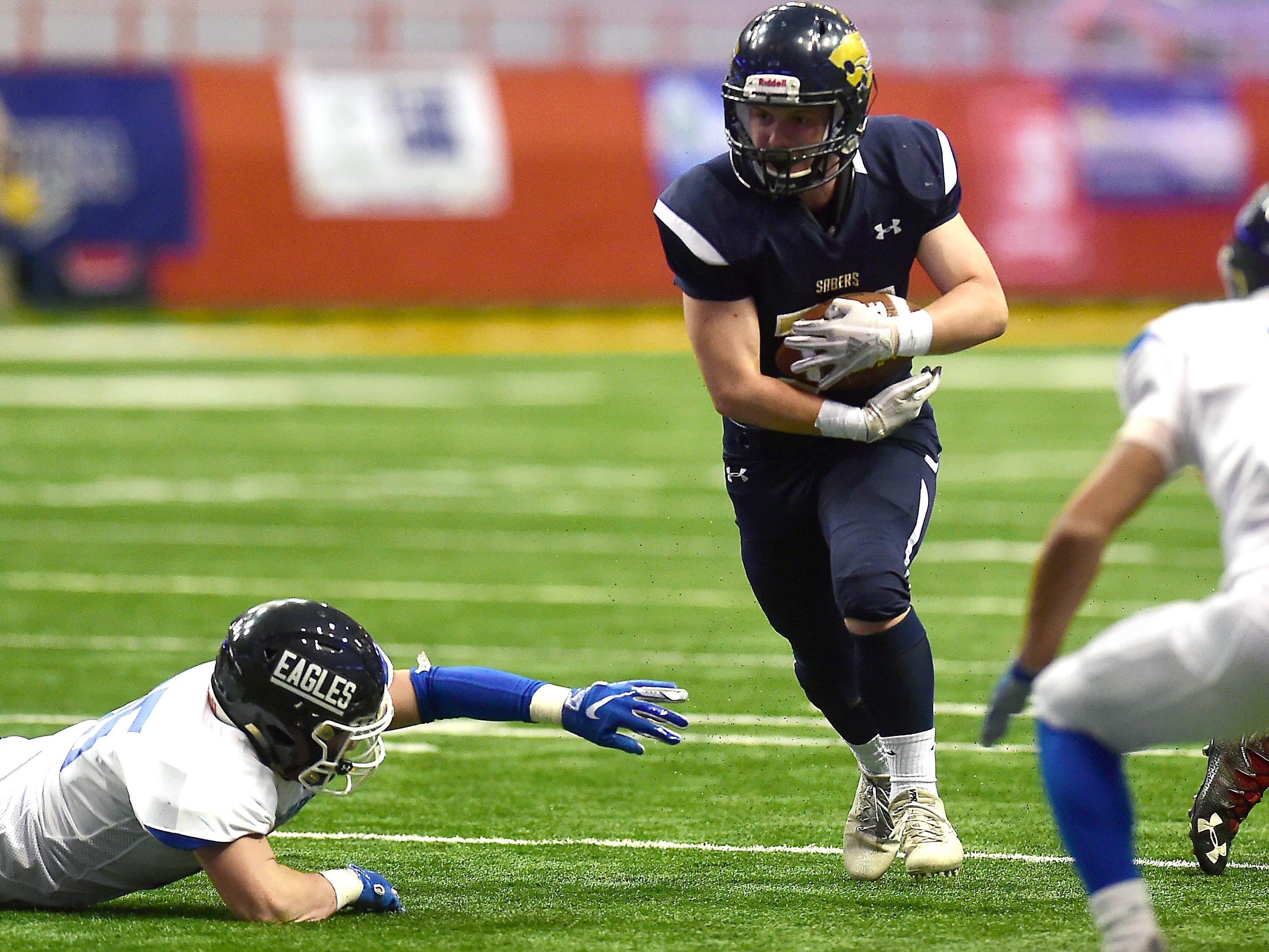 Susquehanna Valley's Joshua Rudock (34) runs with ball during first half of Susquehanna Valley vs. Dobbs Ferry, Class C NYSPHSAA state football final, Carrier Dome, Syracuse. Friday, November 23, 2018.