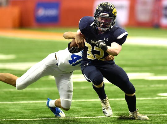 Keyle Leonard of Susquehanna Valley (32) attempts to get past Justin Morgan (40) during Susquehanna Valley's 27-6 win over Dobbs Ferry for the Class C state championship fina in the  Carrier Dome, Syracuse. Friday, November 23, 2018.