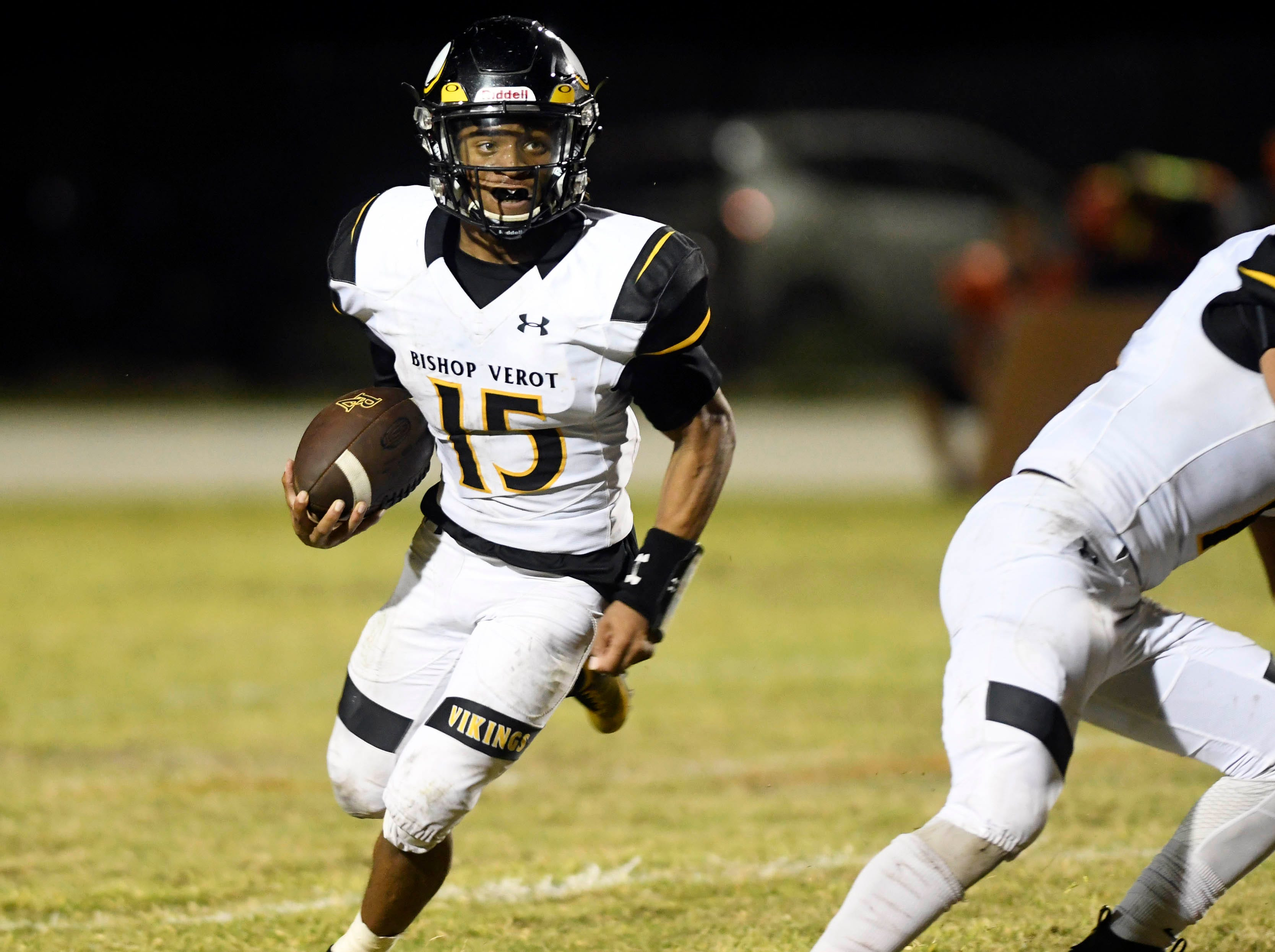 Teqoun Chatman of Bishop Verot runs the ball during Friday's game against Cocoa.