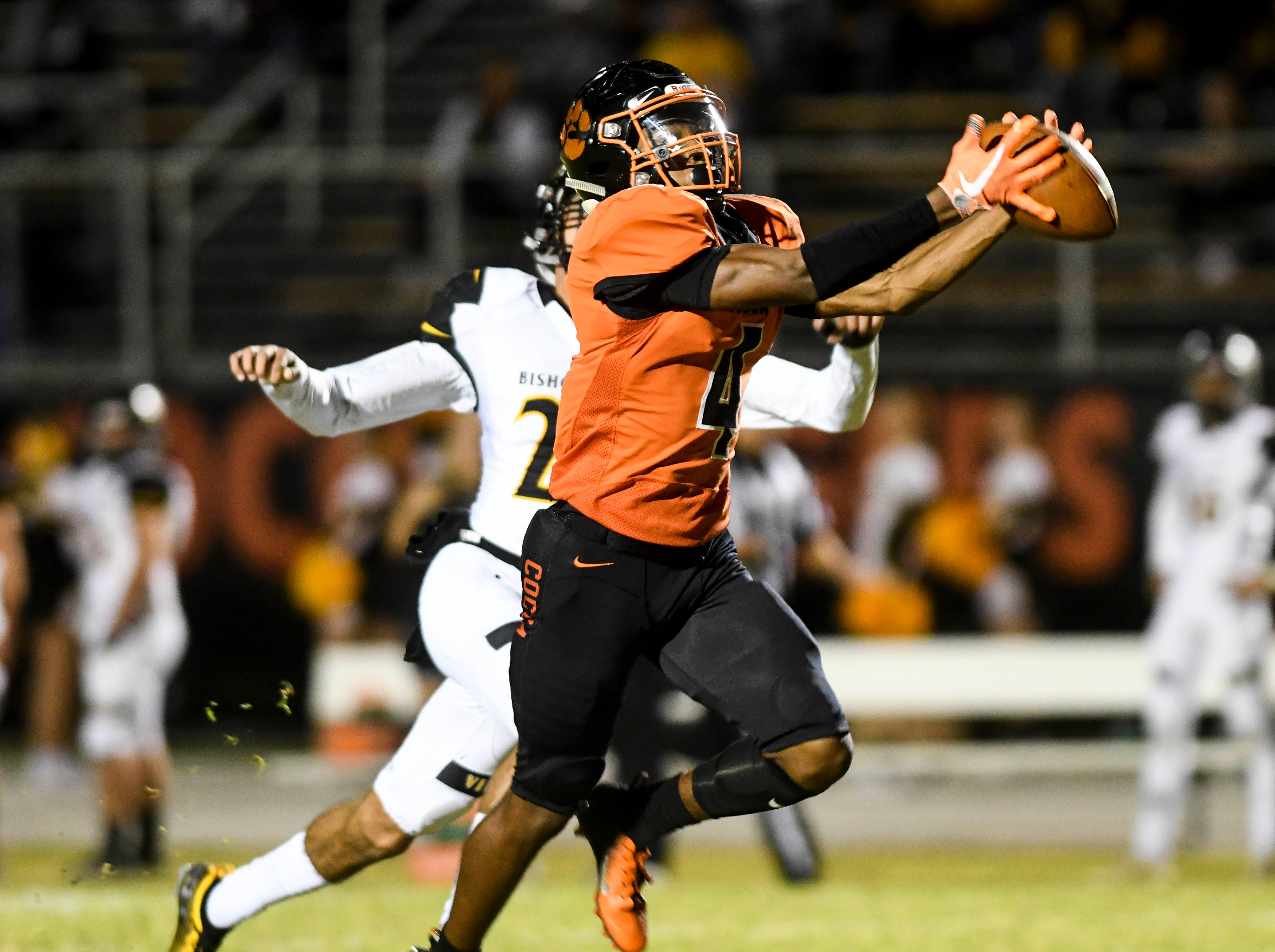 WIllie Gaines of Cocoa catches a TD pass in front of Lucas Tejera of Bishop Verot during Friday's regional championship.