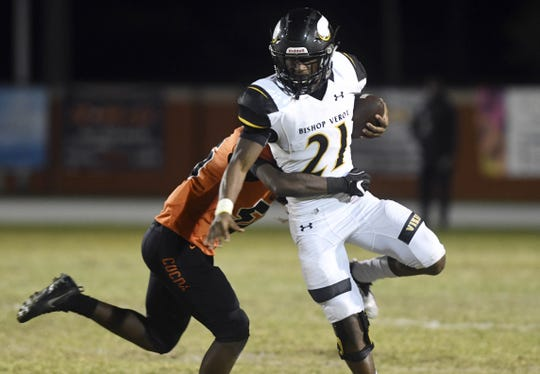 Terry Lindsey of Bishop Verot is brought down by Cocoa's AJ Williams during Friday's game at Blake Stadium.