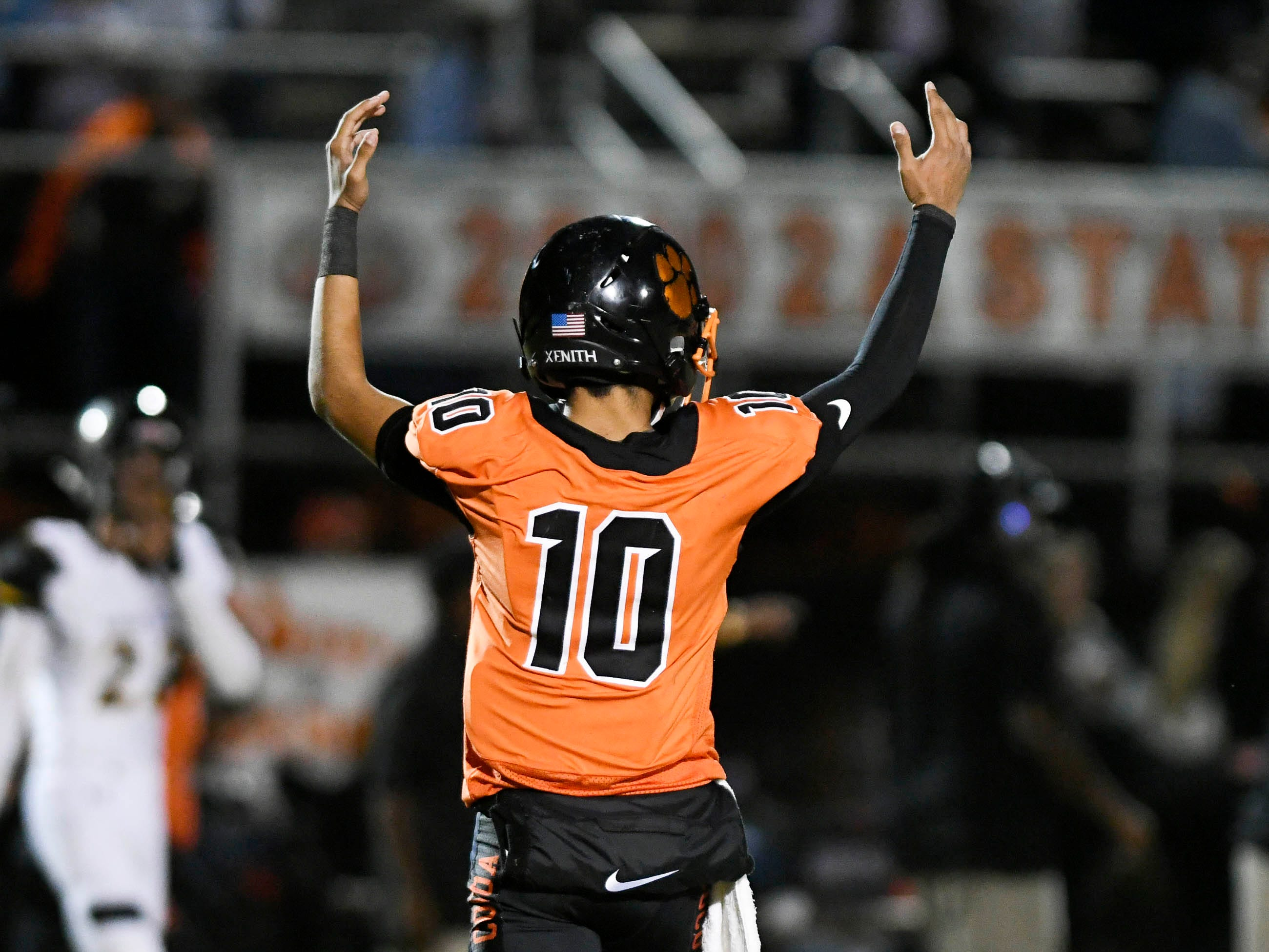 Cocoa QB Diego Arroyo signals a Tiger touchdown during Friday's game.