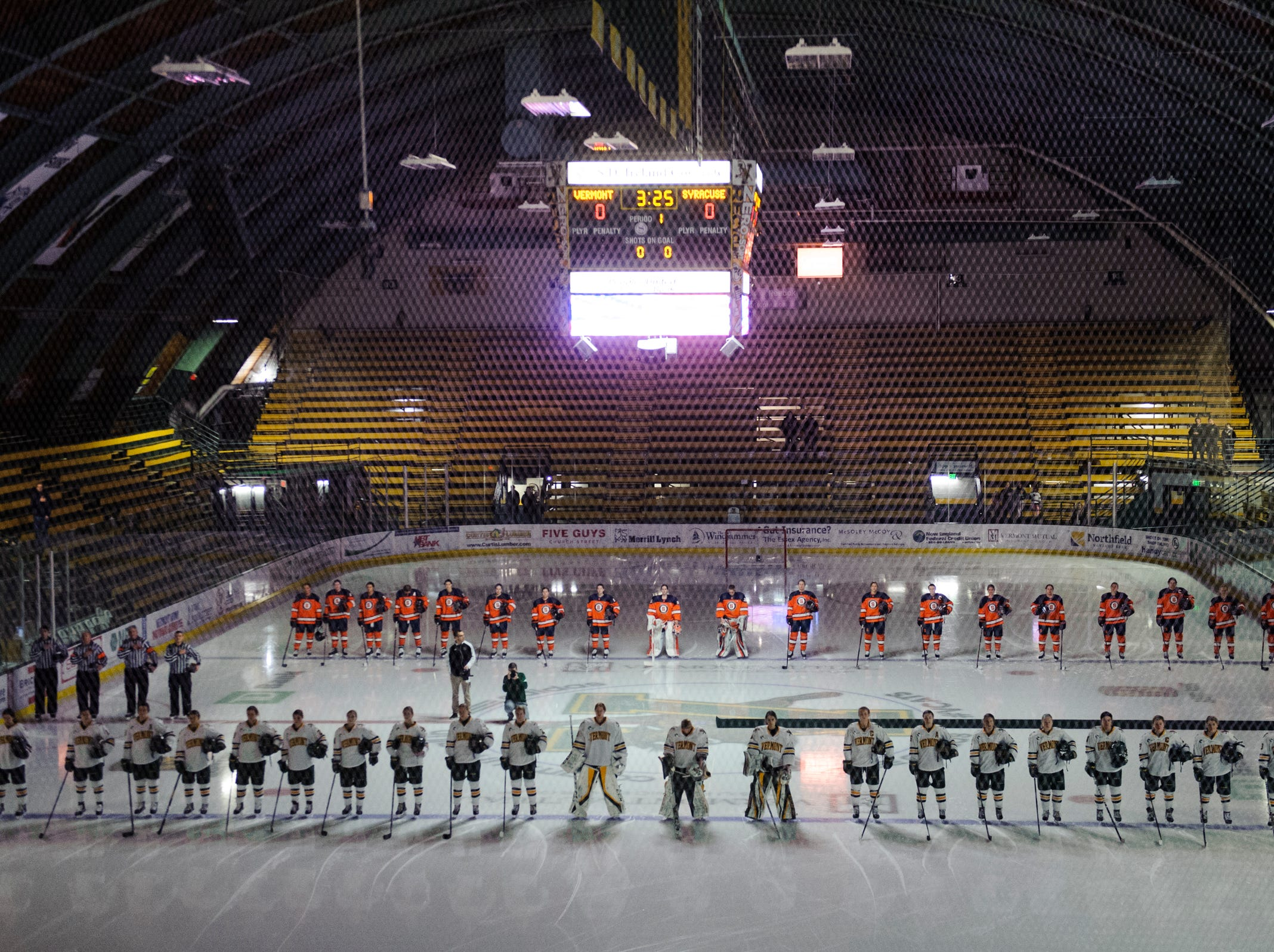 The teams listen to the National Anthem during the women's hockey game between the Syracuse Orange and the Vermont Catamounts at Gutterson Field House on Friday night November 23, 2018 in Burlington.