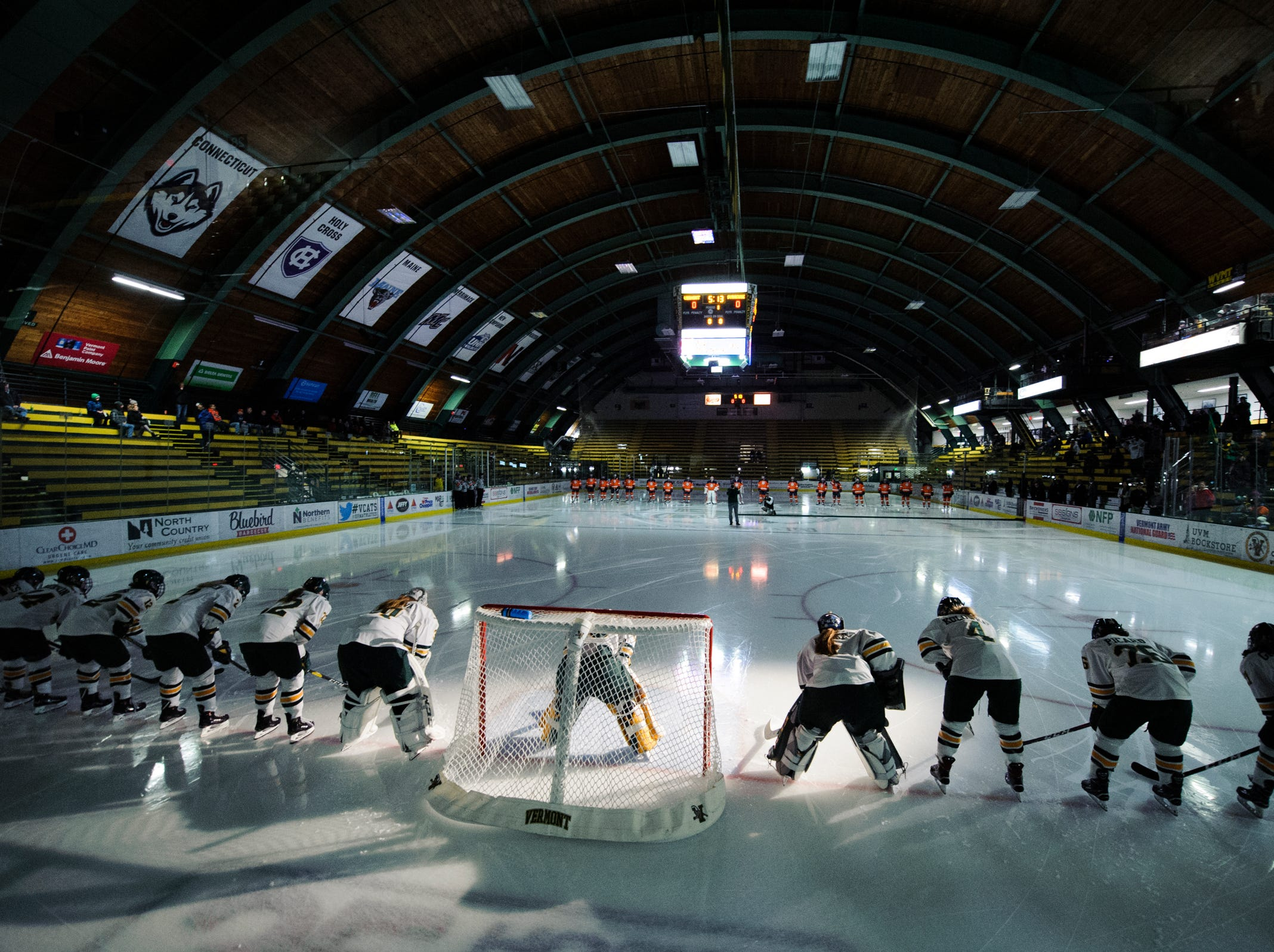 Vermont lines up for player introductions during the women's hockey game between the Syracuse Orange and the Vermont Catamounts at Gutterson Field House on Friday night November 23, 2018 in Burlington.