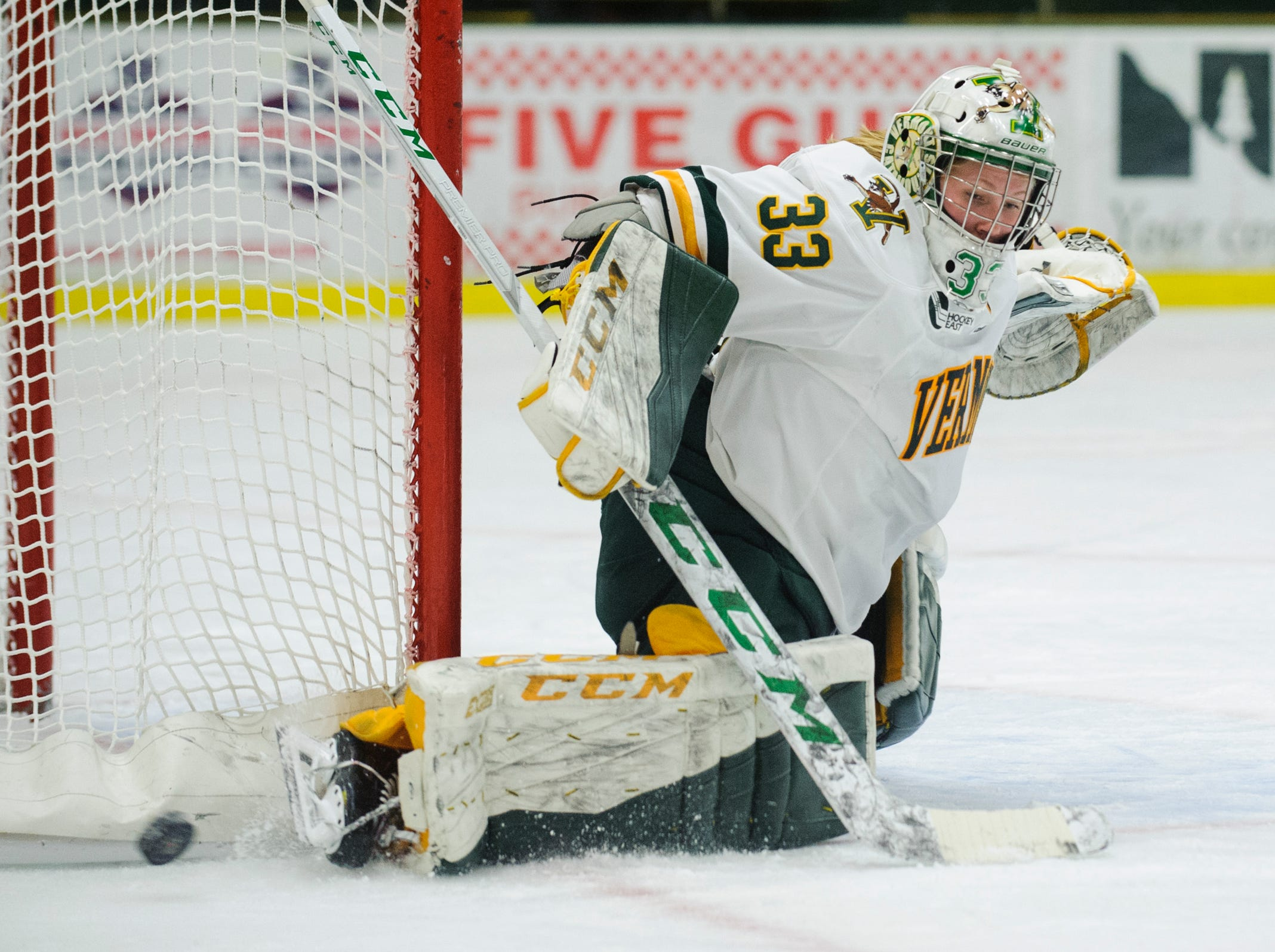 Vermont goalie Melissa Black (33) makes a save during the women's hockey game between the Syracuse Orange and the Vermont Catamounts at Gutterson Field House on Friday night November 23, 2018 in Burlington.