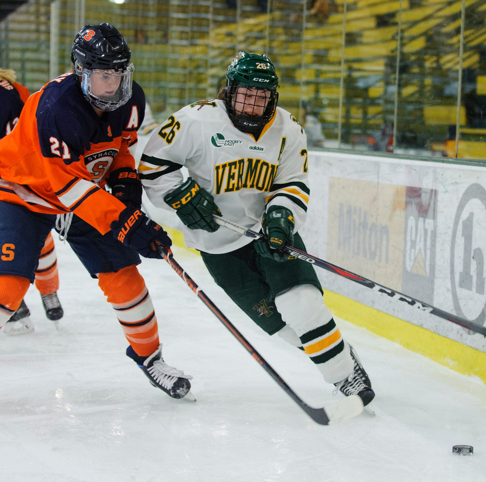 Vermont's Eve-Audrey Picard (26) battles for the puck with Syracuse's Brooke Avery (21) during the women's hockey game between the Syracuse Orange and the Vermont Catamounts at Gutterson Field House on Friday night November 23, 2018 in Burlington.