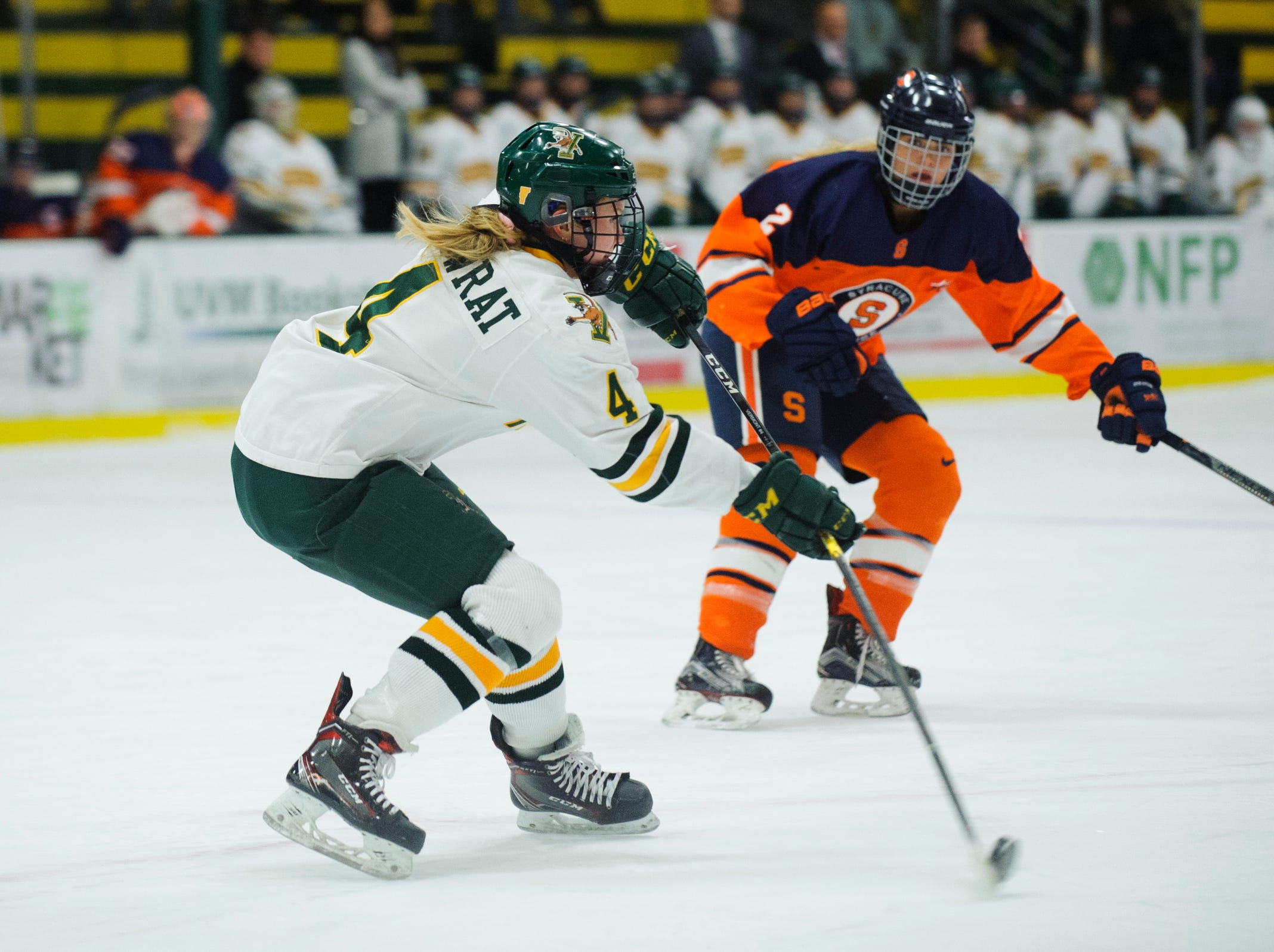 Vermont's Sammy Kolowart (4) shoots the puck down the ice during the women's hockey game between the Syracuse Orange and the Vermont Catamounts at Gutterson Field House on Friday night November 23, 2018 in Burlington.