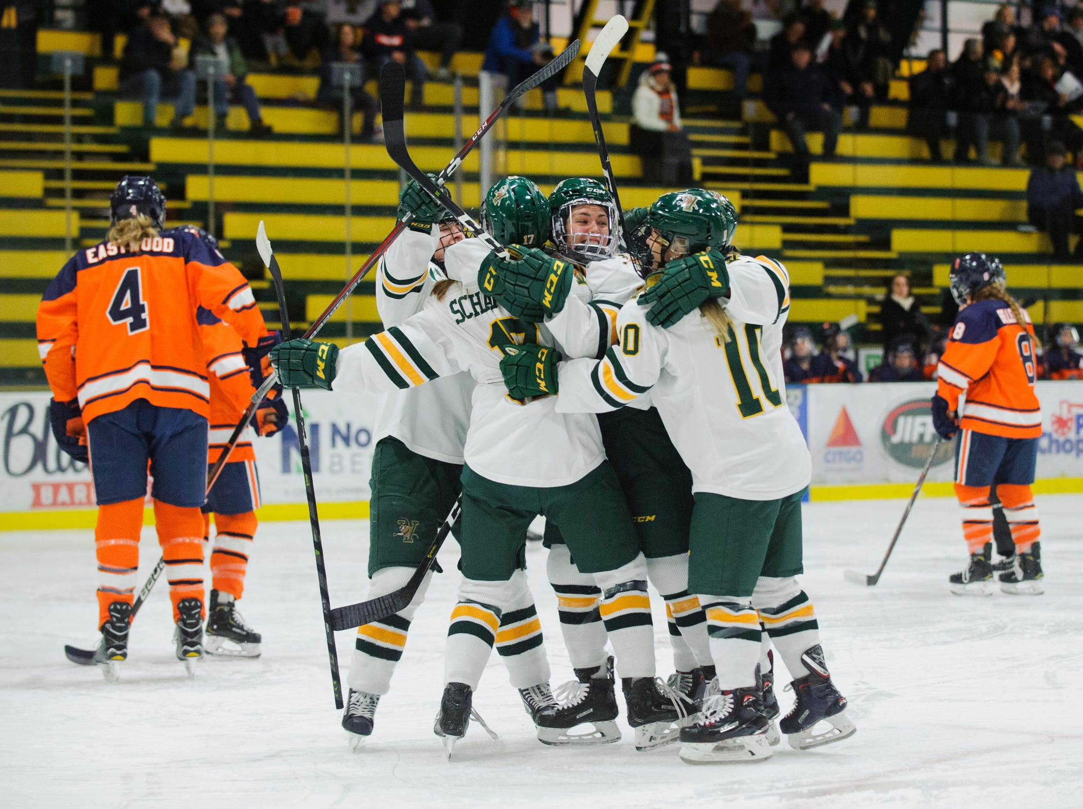 Vermont celebrates a goal during the women's hockey game between the Syracuse Orange and the Vermont Catamounts at Gutterson Field House on Friday night November 23, 2018 in Burlington.