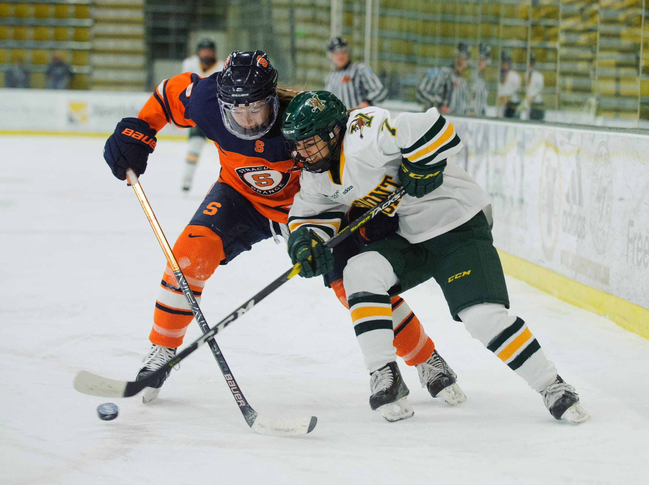 Vermont's Lristina Shanahan (7) battles for the puck with Syracuse's Lauren Bellefontaine (8) during the women's hockey game between the Syracuse Orange and the Vermont Catamounts at Gutterson Field House on Friday night November 23, 2018 in Burlington.