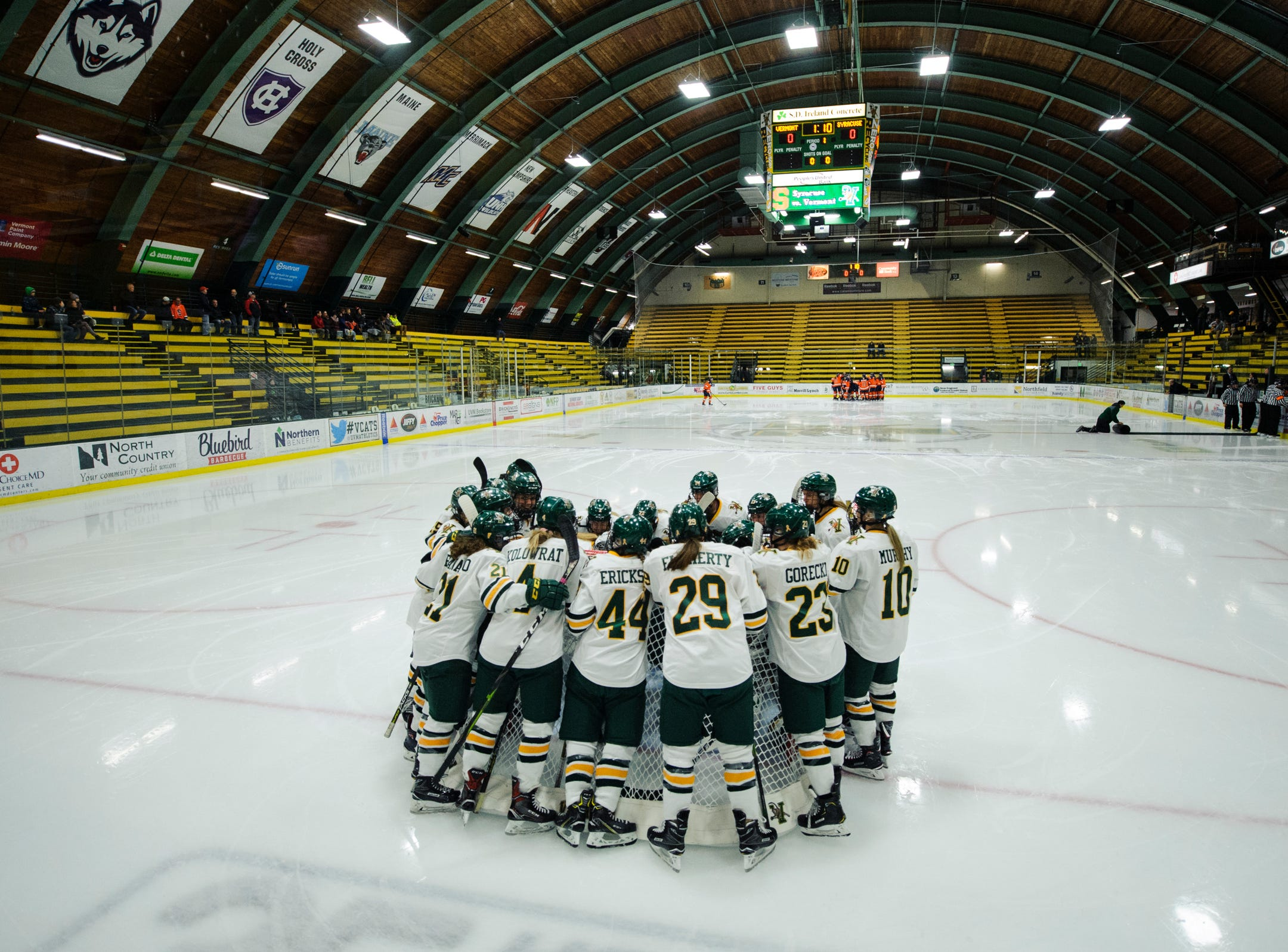 Vermont huddles together during the women's hockey game between the Syracuse Orange and the Vermont Catamounts at Gutterson Field House on Friday night November 23, 2018 in Burlington.