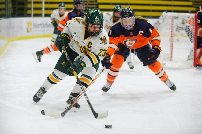 Vermont's Alyssa Gorecki (23) skates with the puck during the women's hockey game between the Syracuse Orange and the Vermont Catamounts at Gutterson Field House on Friday night November 23, 2018 in Burlington.