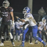 CovCath junior Michael Mayer keeps an eye on Pulaski County's Tristan Cox, a UK commit, during a KHSAA 5A state football semifinal between Covington Catholic and Pulaski County at Pulaski County HS, Somerset KY, Nov. 23, 2018.