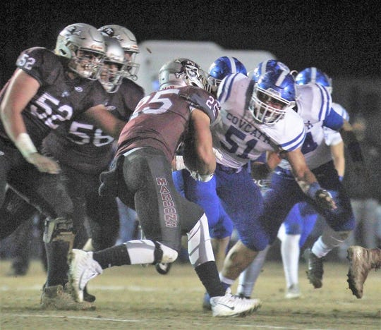 CovCath senior Ross Halverstadt, 51, tackles the runner Tristan Cox, 25, during a KHSAA 5A state football semifinal between Covington Catholic and Pulaski County at Pulaski County HS, Somerset KY, Nov. 23, 2018.