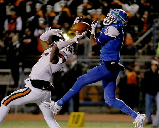 Massillon Washington linebacker Kyshad Mack breaks up a pass in the end zone meant for Winton Woods wide receiver DeMeer Blankumsee during their Division II state semifinal at Gahanna Friday, Nov. 23, 2018.
