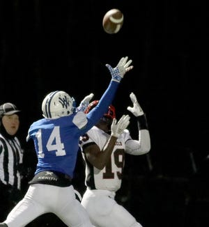 Walton Verona defensive back Travis  Brauer (14) breaks up a pass intended for Mayfield wide receiver  Diaz Perry (19)  during the Bearcats' state semifinal against Mayfield, Friday, Nov. 23, 2018.