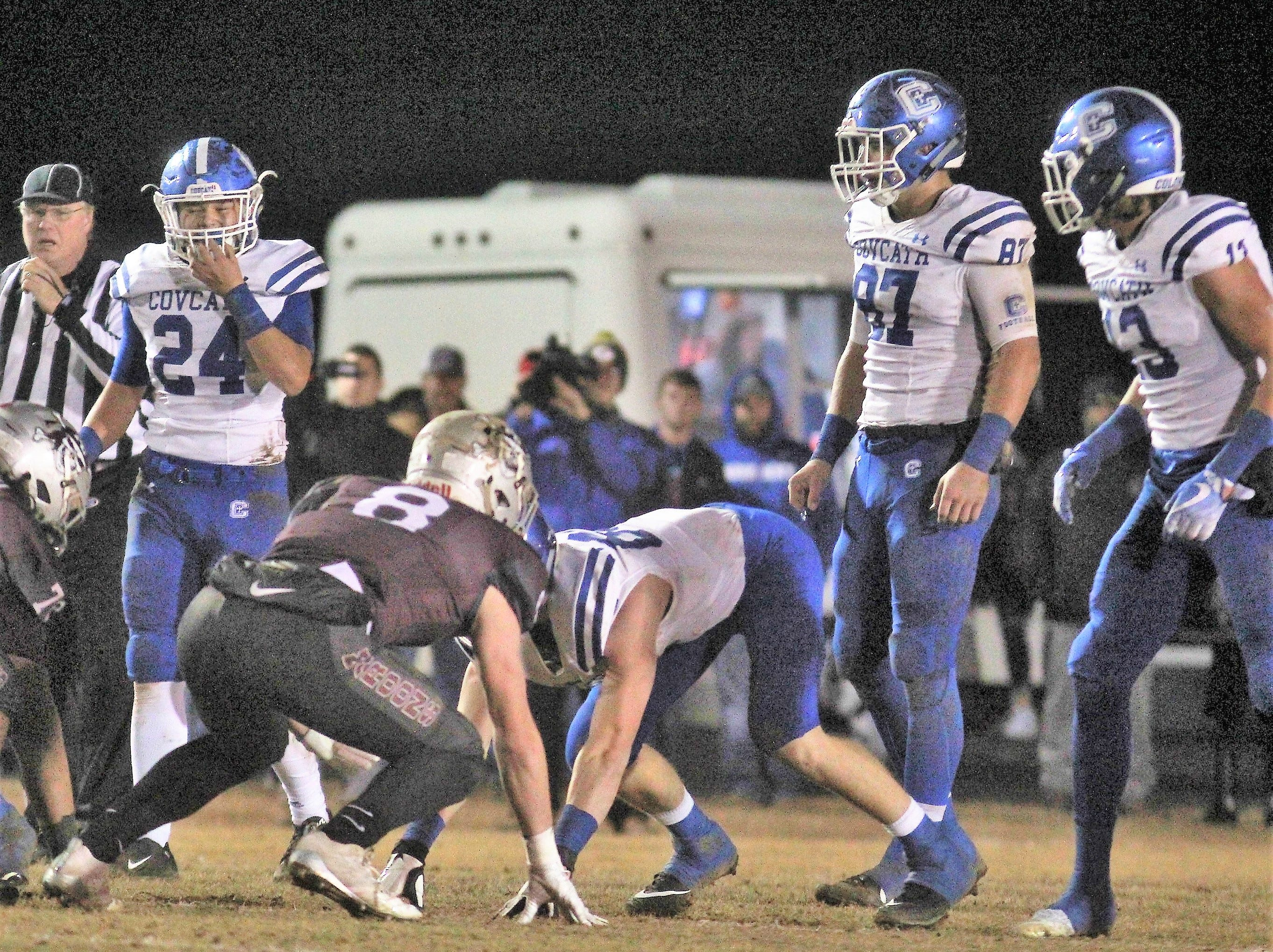CovCath junior Daniel Felix, 24, junior Michael Mayer, 87, and senior Jack Coldiron, 13, get ready for a play on defense during a KHSAA 5A state football semifinal between Covington Catholic and Pulaski County at Pulaski County HS, Somerset KY, Nov. 23, 2018.