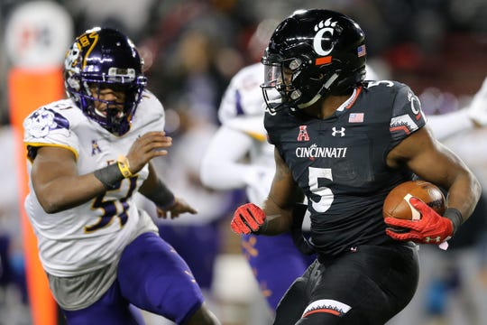 Cincinnati Bearcats running back Tavion Thomas (5) carries the ball in the third quarter of an NCAA college football game against the East Carolina Pirates, Friday, Nov. 23, 2018, at Nippert Stadium in Cincinnati.