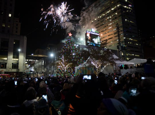 The Macy's Christmas Tree is lit during the Macy's Light Up the Square event on Friday, Nov. 23, 2018, at Fountain Square in Cincinnati.