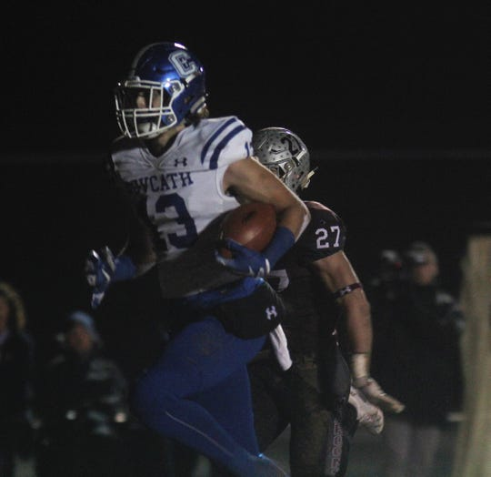 CovCath senior Jack Coldiron outruns a defender for a long TD catch in the first quarter during a KHSAA 5A state football semifinal between Covington Catholic and Pulaski County at Pulaski County HS, Somerset KY, Nov. 23, 2018.