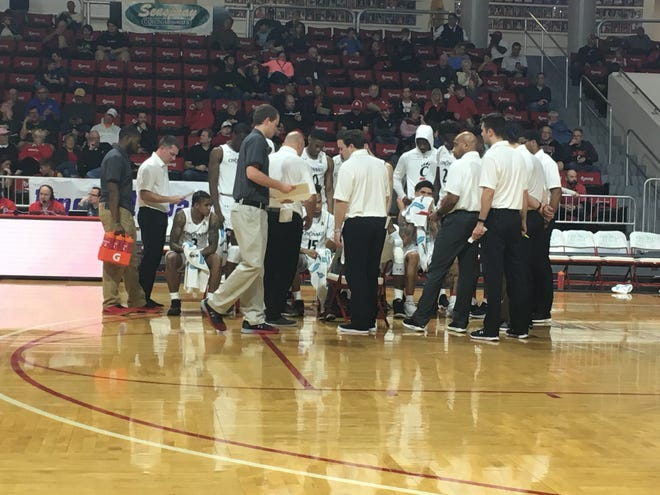 UC huddles up during a Friday night win over George Mason