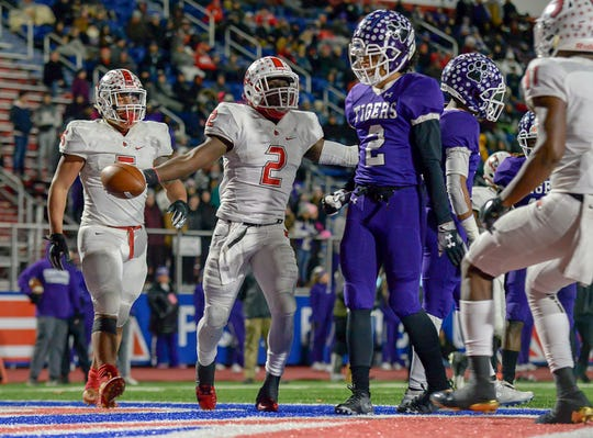 Colerain quarterback Deante Smith-Moore (2) celebrates after scoring a touchdown against Pickerington Central in the OHSAA Region 4 D1 State Semi-Final at Piqua High School, Friday Nov. 23, 2018