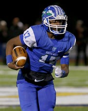 Winton Woods quarterback Mi'Chale Wingfield carries the ball against Massillon Washington during their Division II state semifinal at Gahanna Friday, Nov. 23, 2018.