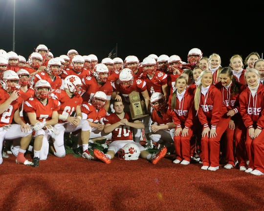"""Beechwood players celebrate with the semifinalist Trophy calling out """"Firewood, Firewood."""" Beechwood defeated Campbellsville 48-13."""