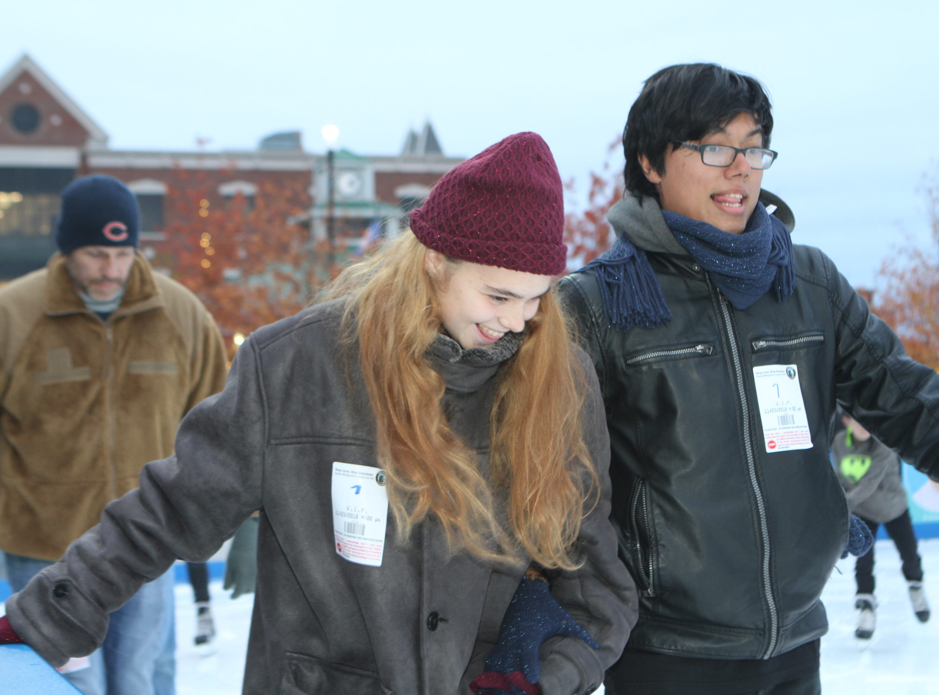 Katelyn Applegate and Yothman Leiva at the Downtown Commons Winter Ice Rink opening on Friday, Nov. 23, 2018.