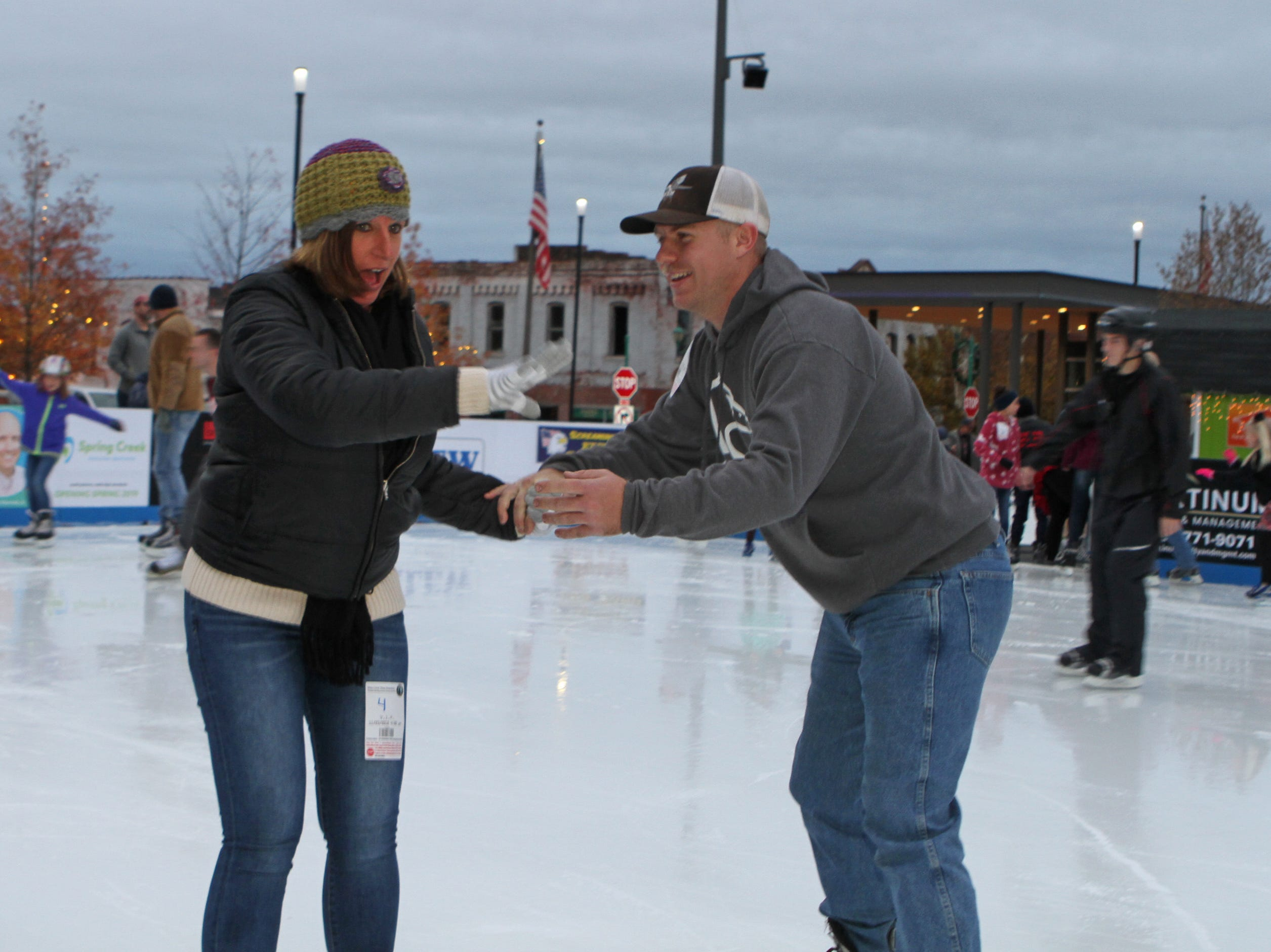 Nicole McMahon and John Rodgers at the Downtown Commons Winter Ice Rink opening on Friday, Nov. 23, 2018.