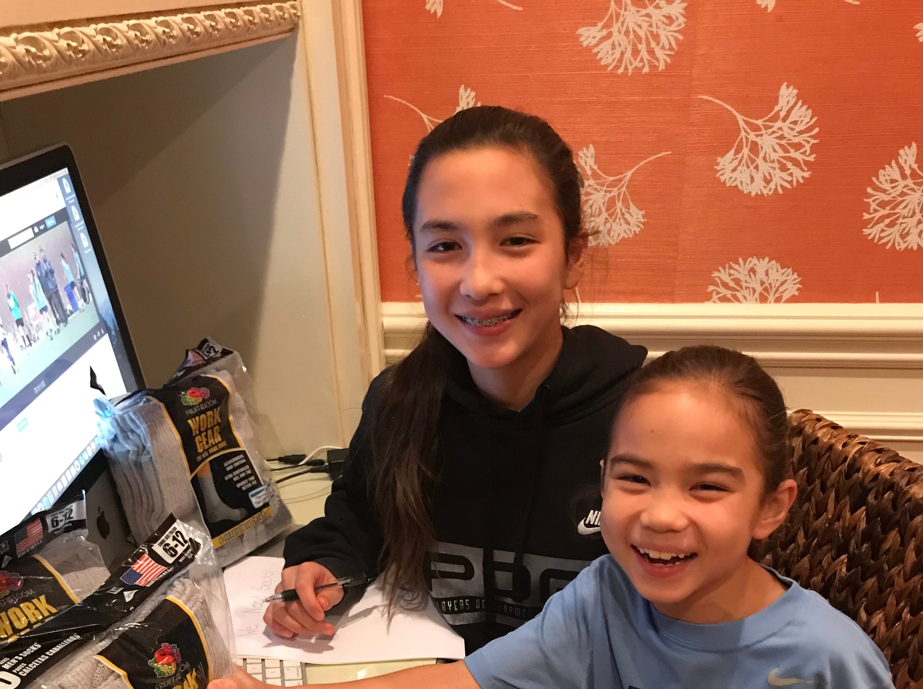 Ainsley and Adele Moy made flyers to distribute within their neighborhood to collect more socks.
