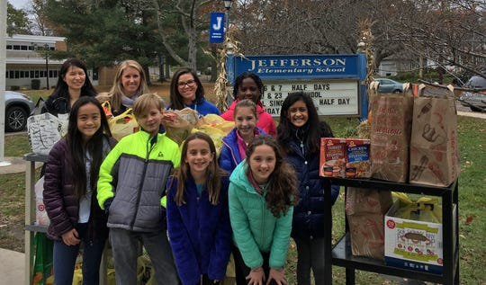 The Early Act Club of Jefferson School coordinated a food drive to help those less fortunate. Members of the club and their advisers, along with Jefferson principal Dr. Susie Hung (upper left), delivered the food items on Tuesday, Nov. 20, to Grace Presbyterian Church.