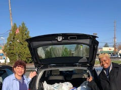 (Left to right) Maria Hodossy, assistant branch manager and Pam Jordan, branch manager, with the over 50 frozen turkeys that were collected recently during Magyar Bank's Food Drive benefiting the Franklin Township Food Bank.