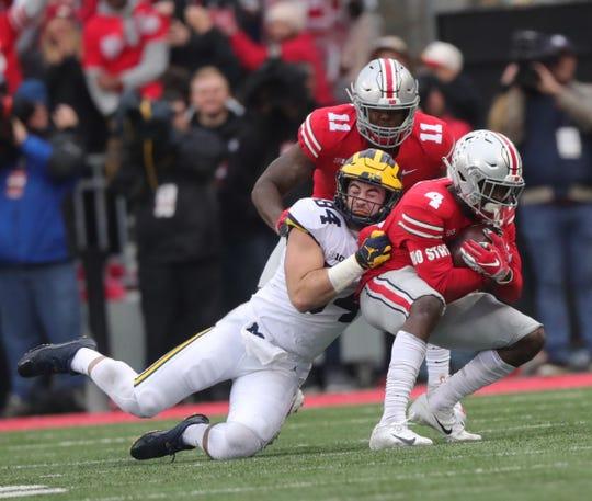 Michigan's Sean McKeon tackles Ohio State safety Jordan Fuller during the first half Saturday, Nov. 24, 2018 at Ohio Stadium in Columbus, Ohio.