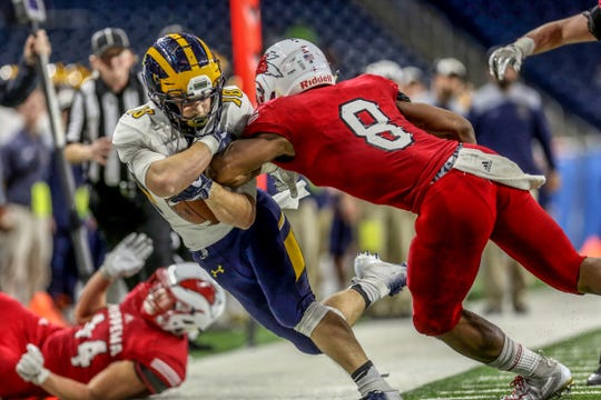 Clarkston Josh Luther catches a pass and runs for more yardage against Chippewa Valley David Ellis who knock him out of bounds, during the Division 1 MHSAA State Championship at Ford Field in Detroit on Saturday, Nov. 24, 2018.