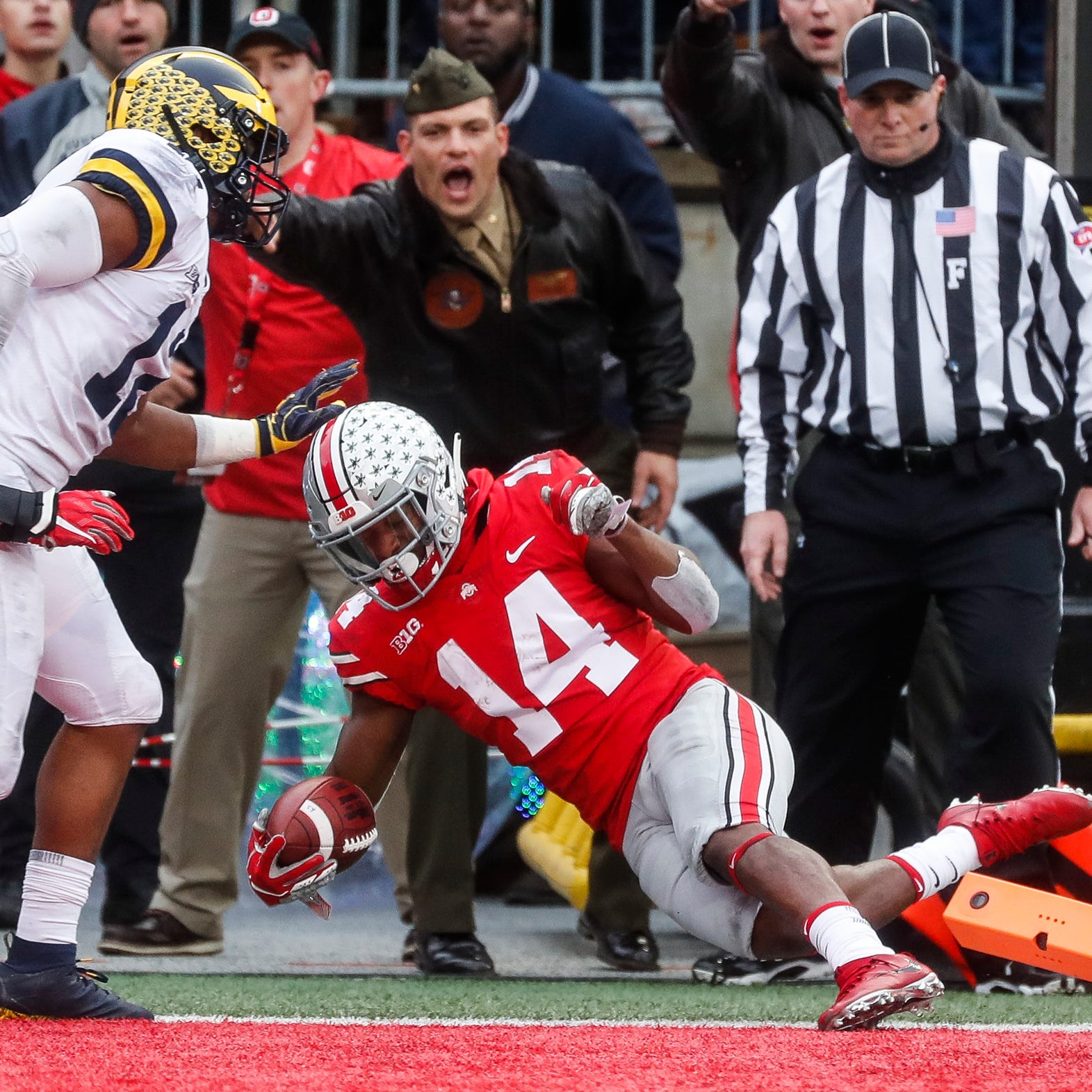 Ohio State wide receiver K.J. Hill (14) runs for...