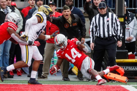 Ohio State receiver K.J. Hill (14) runs for a first down against Michigan during the second half at Ohio Stadium, Nov. 24, 2018. The Buckeyes won, 62-39.