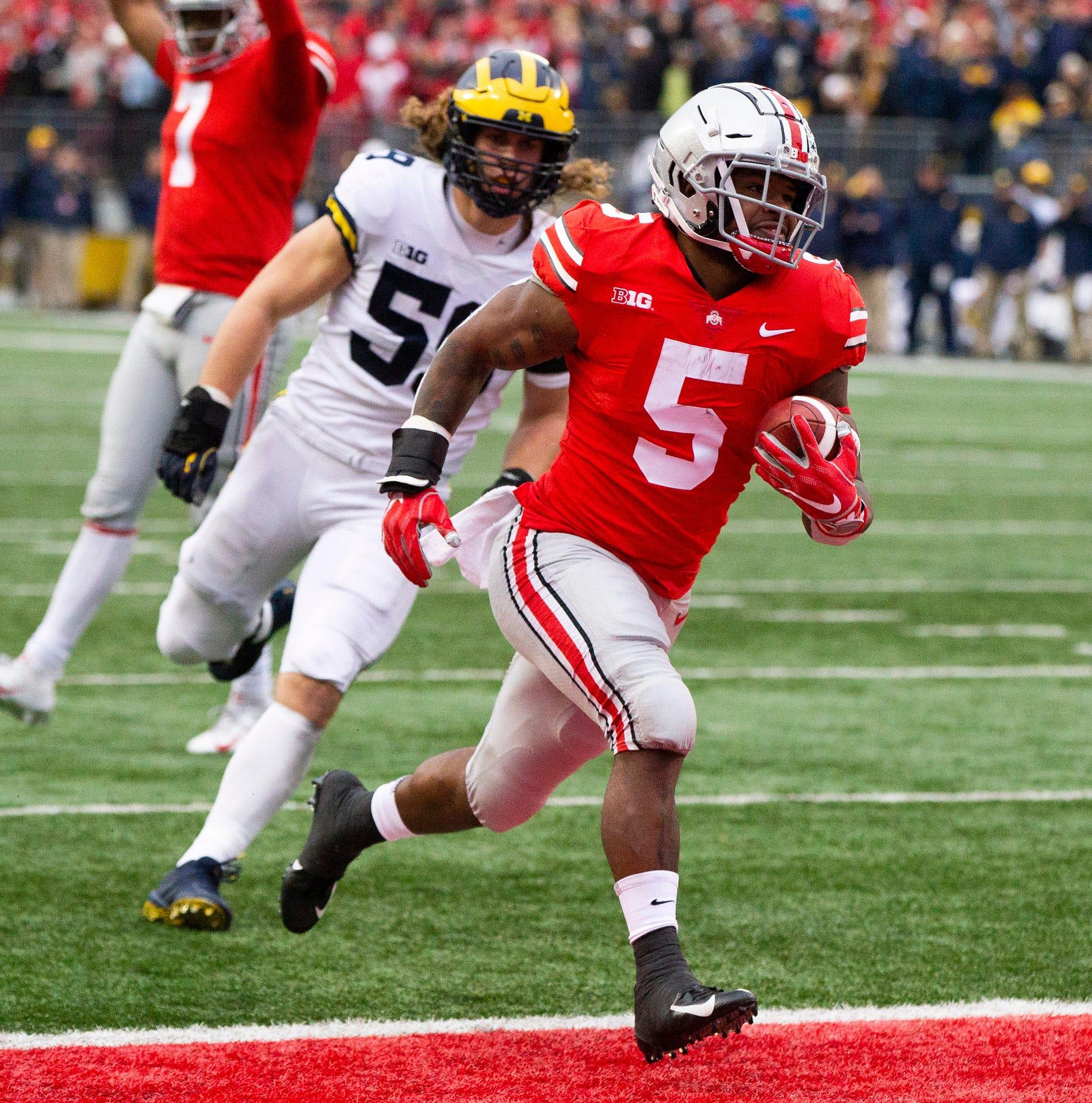 Ohio State running back Mike Weber (5) scores against Michigan linebacker Noah Furbush (59) on Saturday, Nov. 24, 2018, at Ohio Stadium.