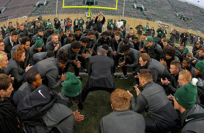 Michigan State head coach Mark Dantonio huddles his team in the end zone prior to the game against Rutgers at Spartan Stadium, Nov. 24, 2018.