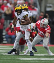 Donovan Peoples-Jones makes a catch against Ohio State last season.
