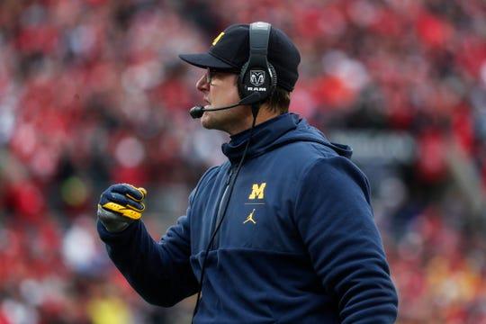 Michigan head coach Jim Harbaugh talks to players during the second half against Ohio State at Ohio Stadium in Columbus, Ohio, Saturday, Nov. 24, 2018.
